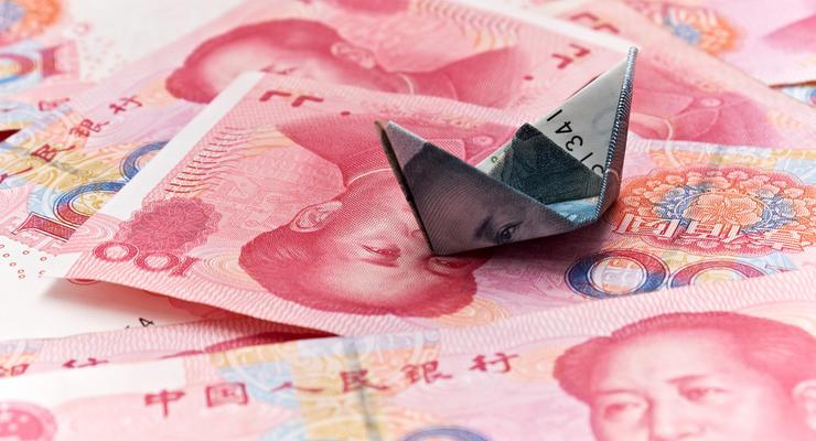 Центробанк Китая повысил справочный курс юаня на 0,3%