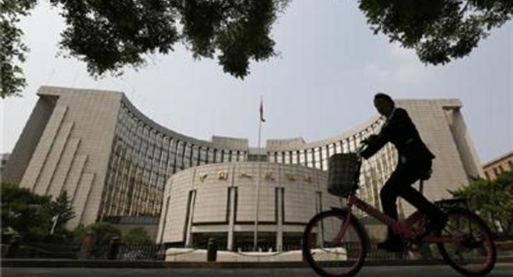 Центробанк Китая повысил курс юаня