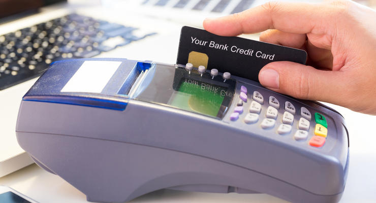 С платежных карт украинцев будут списывать долги за услуги ЖКХ