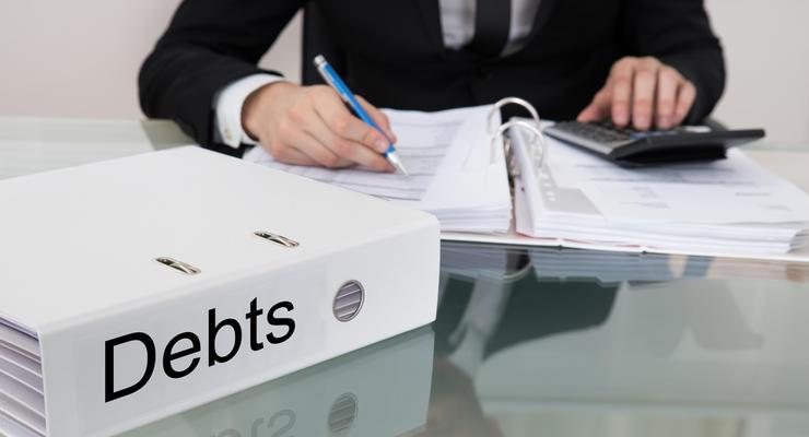 Украина должна отдать 12 млрд долларов долгов за 2 года