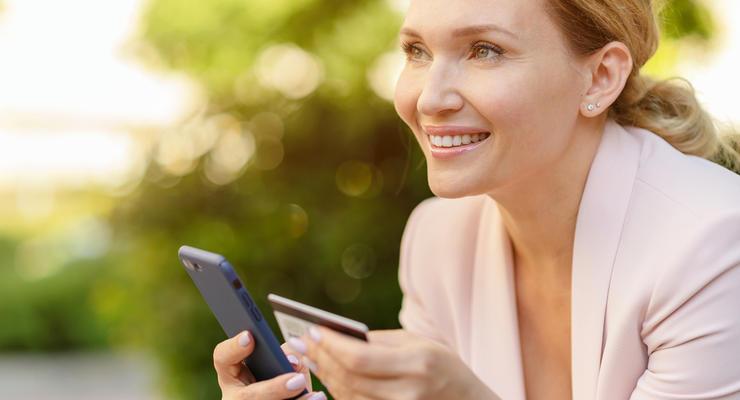 Переводить деньги по номеру телефона теперь можно на карты других банков, — ПриватБанк
